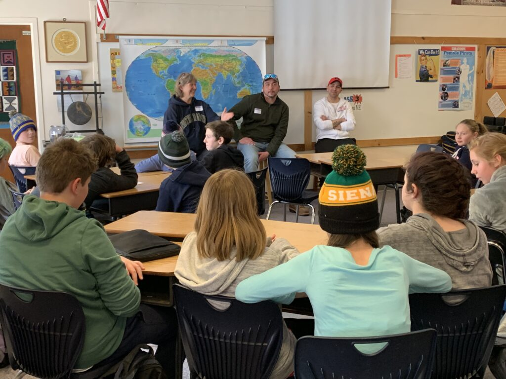 Rutland Dismas House director Terese Black and residents Jason and Travis talk to 6th grade students from the Dorset School.