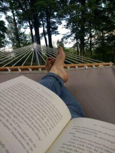 Emily reading in a hammock