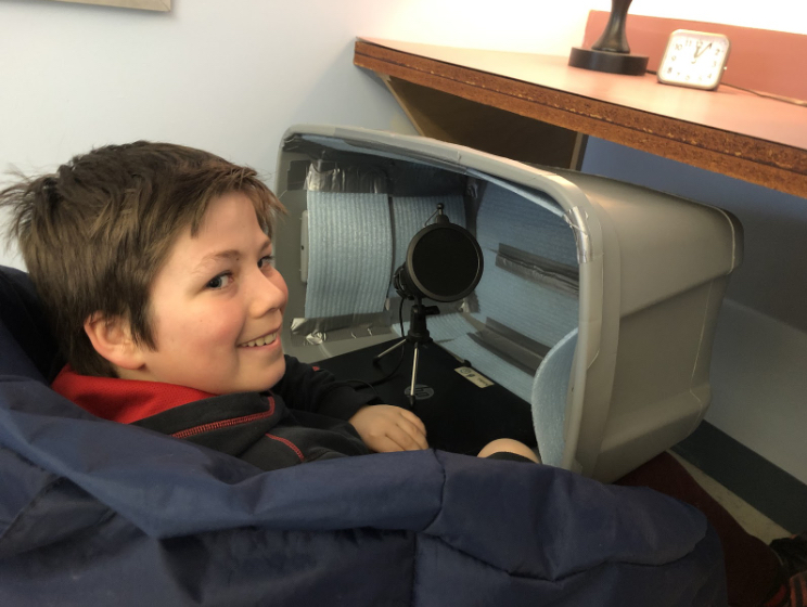 An Alpha 5 student using their homemade podbox.